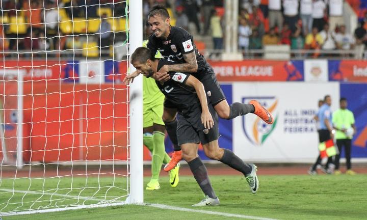 NorthEast United's Emiliano Alfaro and Nicolas Velez celebrates the wining goal against Pune City in Hero ISL match in Pune.jpg