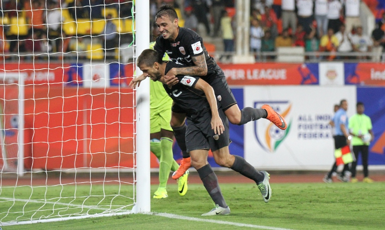 NorthEast United's Emiliano Alfaro and Nicolas Velez celebrates the wining goal against Pune City in Hero ISL match in Pune.jpg