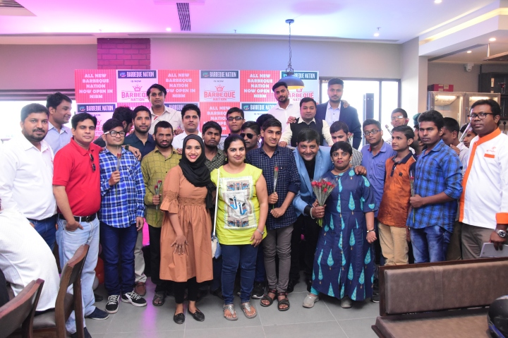 Barbeque Nation's team with the students from Opal Foundation