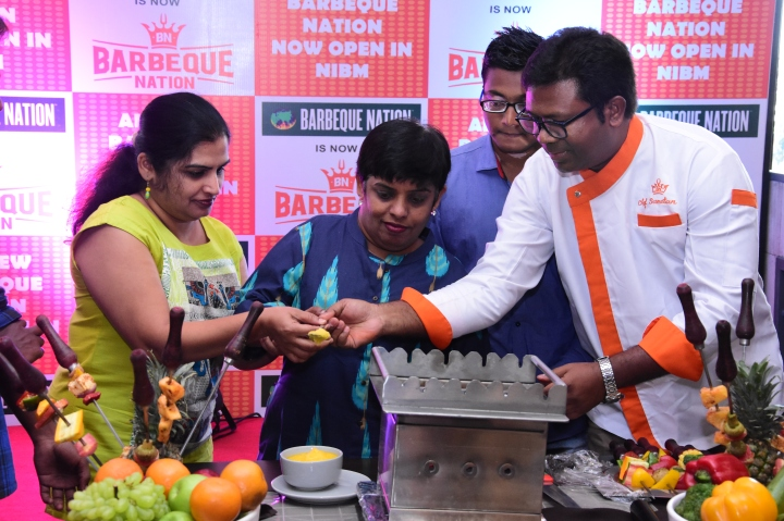 Priyadarshini Nahar liting the flame along with the chef